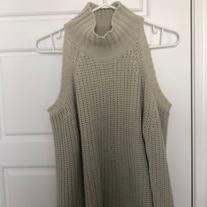 Knitted turtleneck sweater with shoulder cutouts.